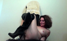 big-breasted-cougar-in-black-boots-pleases-herself-on-webcam