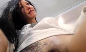 striking-brunette-reveals-her-superb-ass-and-rubs-her-pussy