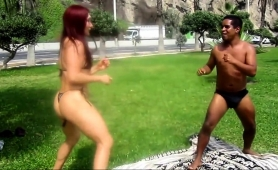 dominant-redhead-in-a-hot-bikini-wrestles-with-a-guy-outside