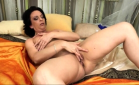 busty-mature-brunette-undresses-and-fingers-her-needy-cunt
