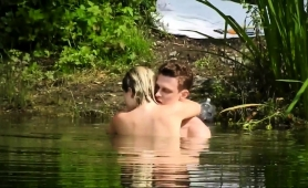 passionate-young-lovers-engage-in-hot-sex-action-in-the-lake