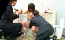 stacked-oriental-slave-used-by-two-guys-in-a-public-toilet