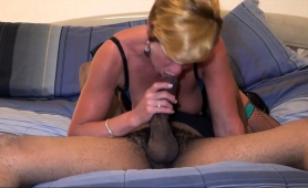 busty-blonde-cougar-in-lingerie-gives-a-big-black-cock-a-try