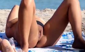 nudist-beach-voyeur-finds-a-busty-babe-with-a-juicy-snatch
