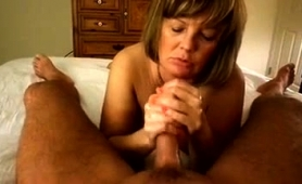 sensuous-mature-wife-works-her-skillful-hands-on-a-pov-cock