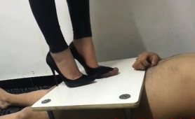 dominant-asian-lady-in-high-heels-punishes-her-naughty-slave
