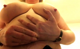 naughty-mature-lady-puts-her-big-natural-breasts-on-display