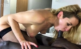 wild-blonde-in-stockings-does-everything-to-a-big-black-cock