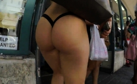 fascinating-blonde-babe-exposes-her-heart-shaped-ass-outside