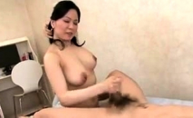 big-breasted-japanese-milf-works-her-magic-on-a-meat-prick