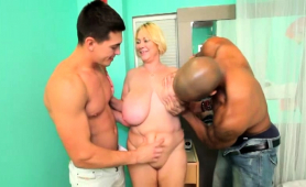 big-breasted-blonde-milf-works-her-lips-on-interracial-cocks